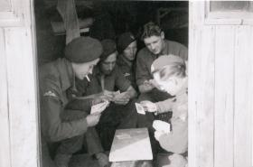 Members of 6th Airborne Divisional Signal Regiment playing cards, Palestine c1947-8.