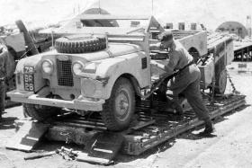 A member of 2 PARA with a Land Rover on a Medium Stress Platform, Libya, 1959.