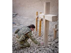 Musician Kate Whittaker visits the Cross at Camp Bastion in tribute to her brother, Afghanistan 2011