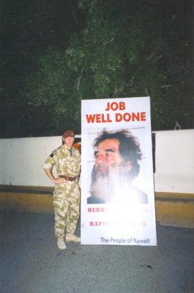 Para pictured with a sign recognising the capture of Saddam Hussein, Kuwait, 2003