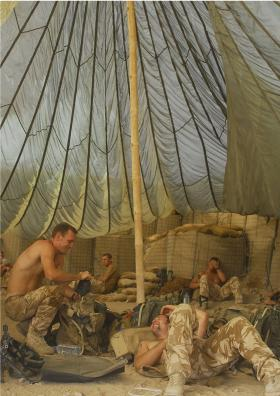 Paras display their Airborne initiative as a parachute is used as a roof, FOB Robinson, Afghanistan, July 2008