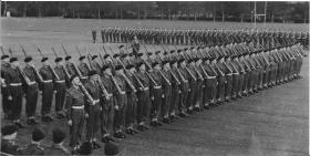 Trooping the Colour parade at attention, Barrosa Square,Aldershot 1958.