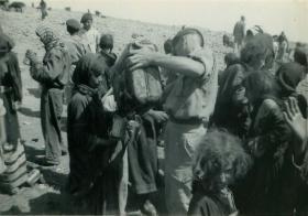 Members of 3 PARA give water to refugess in Amman, Jordan 1958