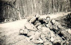 Five paratroopers have a roadside rest on the way to Wismar.