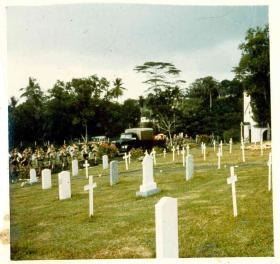 The cortège for Sgt McNeilly's reinterrment arriving at Kranji Military Cemetery, 1975.