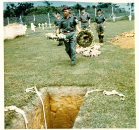 Wreath being placed at the reinterrment of Sgt McNeilly, Kranji Military Cemetery, 1975.