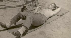 Patrick McNeilly sunbathing while serving in the Australian Army, 1950s.