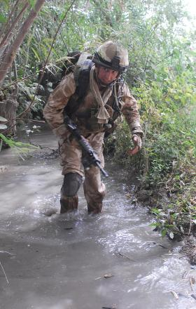 2 PARA soldier patrolling through an irrigation ditch, Afghanistan, July 2008