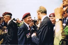 HRH Prince Charles speaks to Paul Aller at the 60th Aniversary of D-Day, 2004