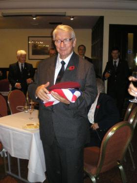 Major Timothy's nephew with the drape and beret after the presentation by OC  C (Bruneval) Coy, 3 Nov 2011