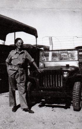 Pte Denis Pendlebury at the military car park, Jerusalem, 8 June 1946.
