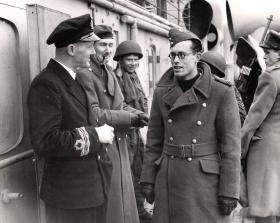 Commander HB Peate, of HMS Prins Albert, talks with Flt Lt DH Priest after the operation, Bruneval, 1942.