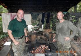 WO2 DSM Phil Stout and Dutch marine prepare scoff in the jungle base camp, Ulu Labi, 2015.