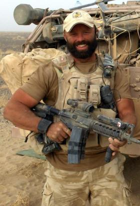 Sgt Tom Blakey on patrol during Op Herrick IV, Afghanistan, 2006.