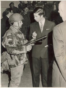 Prince Charles being shown shown a Sterling SMG by a L/Cpl of A Coy 4 PARA at Pudsey, 1970