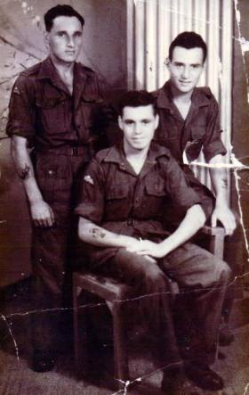 Private A E Porter, with other members of the 7th Battalion, c1945.