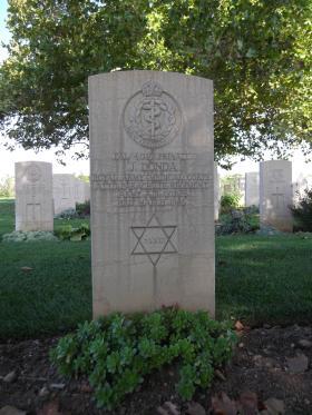 Headstone of Pte J Donda, Bari War Cemetery, November 2011.