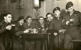 Cpl J R Logan enjoys a beer with friends, Hanover 1948.