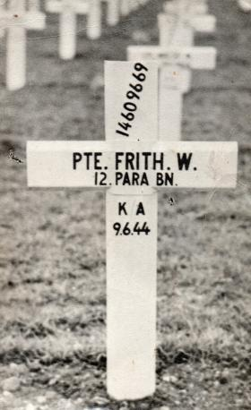 Pte W Frith's grave marker in Ranville Cemetery, 1945-6.