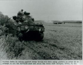 British troops engaged with enemy troops in fight for Caen bridges.