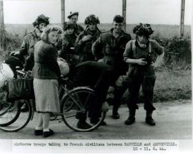 Airborne troops talk to French civilians between Ranville and Amfreville.