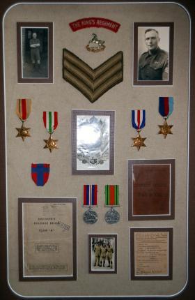 Sgt B Quinn's service book, photos and medals.