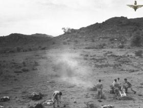 Members of C Troop 97 Fld Bty 33rd Para Light Regt RA dealing with snipers near Mahaw Waddi, c1957.