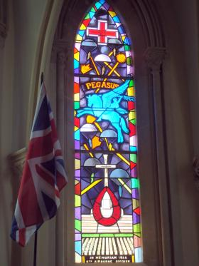 Stained glass window commemorating the 6th Airborne Division in Ranville Church, Normandy, France, 2014.