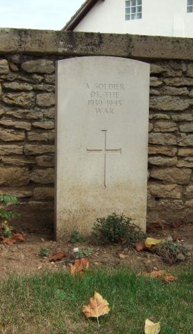 Headstone of an unknown solider, Ranville Churchyard, August 2010.