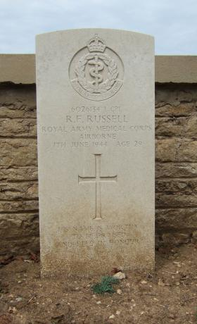 Headstone of L/Cpl R Russell, Ranville Churchyard, August 2010.