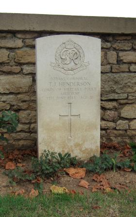 Headstone of Cpl Henderson, Ranville Cemetery, August 2010.
