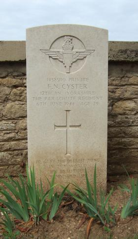 Headstone of Pte Cyster, Ranville Churchyard, August 2010.