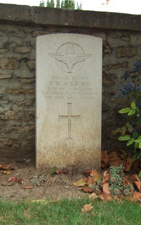 Headstone of Pte E Blackburn, Ranville Churchyard, taken August 2010.