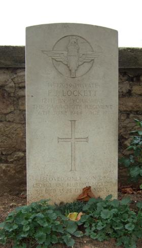 Headstone of Pte P Lockett, Ranville Churchyard, August 2010.