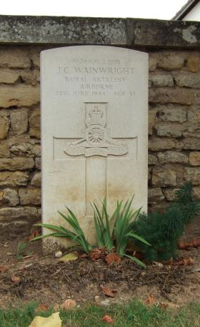 Headstone of L/Bdr John Wainwright, Ranville Churchyard, August 2010.