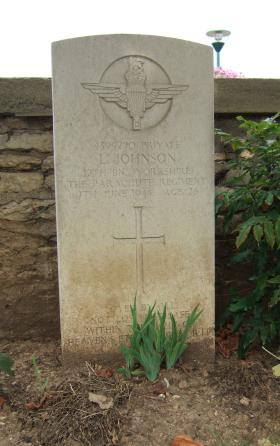 Headstone of Pte L Johnson, Ranville Churchyard, August 2010.