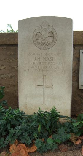 Headstone of Sgt J Nash, Ranville Churchyard, taken August 2010.
