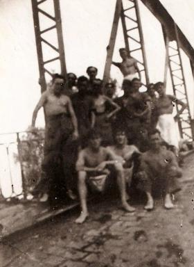 Members of 4th Para Bn ready for a swim at a blown bridge over the River Argens near Frejus, South of France, August 1944.