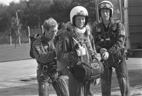 The Late Jim Coffey and Albert Owens helping a young lady get ready for her first parachute descent c1976