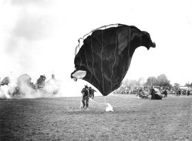 A member of the Parachute Regiments Freefall Team landing at a public display, 1964