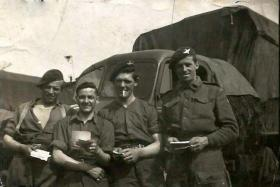 Pte Reg Foley (2nd from right) and pals reading their post c1944.
