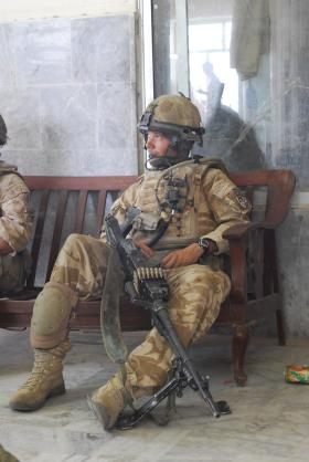 Soldier from A Coy, 3 PARA rests with a GPMG, Kandahar, Afghanistan, 2008