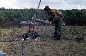 Cpls Rick O' Shea and Ralph Griffin in the field, near Aldershot, 1970s.