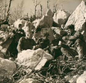 Members of 2nd Parachute Brigade rest among rocks near Cassino.