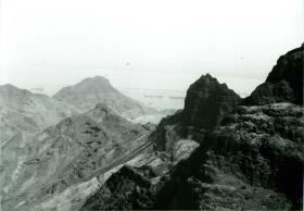Rocky terrain overlooking oil refinery, Aden, c.1967