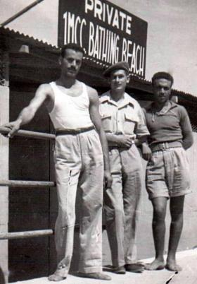 Sgt Ron Goodwin (centre), 6th (Welch) Para Bn, at the beach, Palestine.