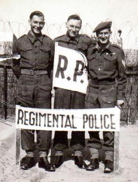 Right, Sgt Ron Goodwin, 6th (Welch) Bn, at Regimental Police Post, Palestine.