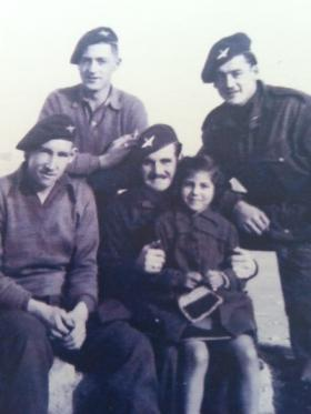 Men of 6th (Royal Welch) Parachute Battalion with a child, undated.