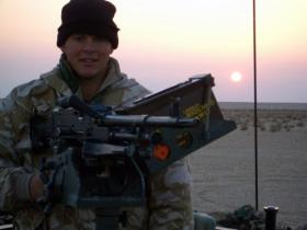 Pte 'Ross' Phillipson manning a GPMG,  Iraq, 2005.
