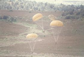 A member of 10 PARA landing on Hankley Common with reserve deployed, ABF Day 1985.